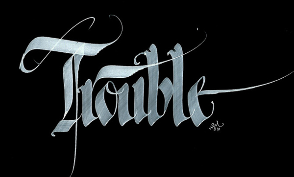 Calligraphie blanche sur fond noir