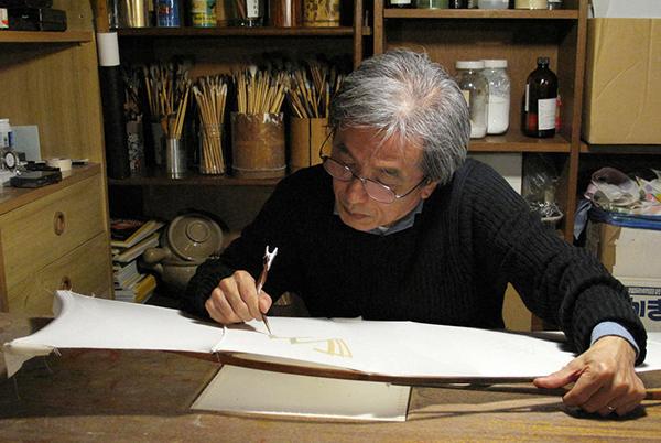 Portrait de l'artiste en train de dessiner